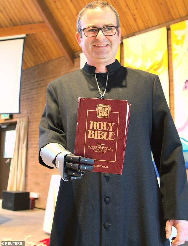 Vicar Dan Cant, 42, from Colchester, Essex, who lost his right forearm in a car crash in 2005, is the first vicar to receive one of the prosthetic arms made by Open Bionics