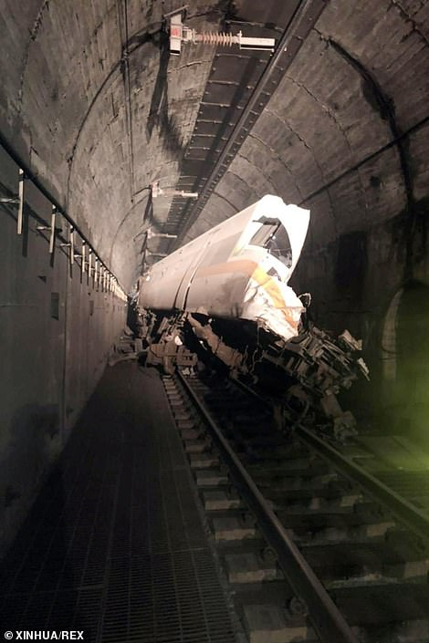 A crumpled train carriage is seen in a tunnel outside Taitung