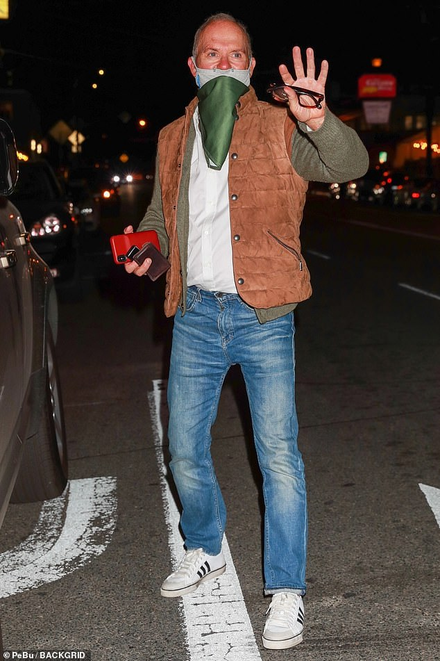 Low-key look: Michael Keaton puton a relaxed display in a burnt orange gilet, corduroy cardigan and jeans on Thursday as he ate dinner at Giorgio Baldi's restaurant in Santa Monica