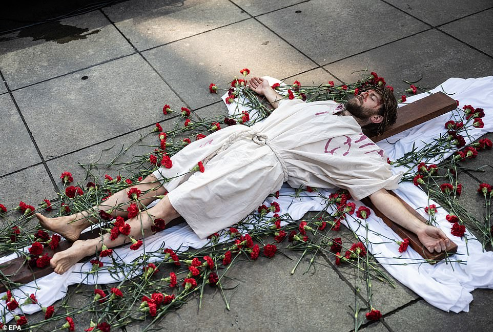 AUSTRALIA: A Catholic man acting the part of Jesus takes part in celebrations on Martin Place on Friday