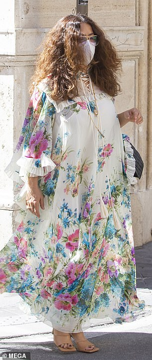 Flower power: Looking every inch the bohomian babe, Salma dazzled in a flowing floral gown that flared over her hourglass curves
