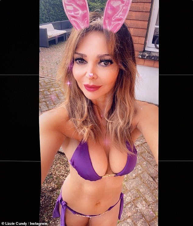 Bunny girl: She's never been afraid to show off her incredible figure. So Lizzie Cundy didn't hesitate to strip down for the Easter weekend heatwave, snapping selfies in a tiny bikini