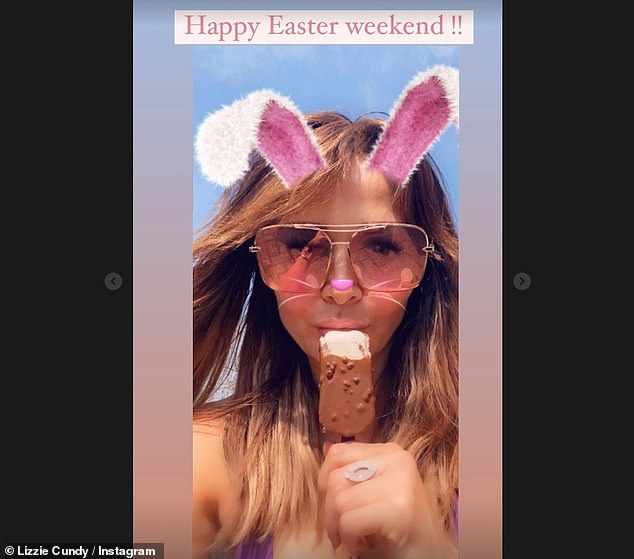 Feeling festive: Clearly in the festive spirit, the 52-year-old TV personality added a bunny ears filter as she cooled off with an ice cream in her garden
