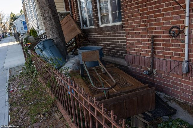 Junk is seen stacked up near the sidewalk of Sakash's Queens home on Friday