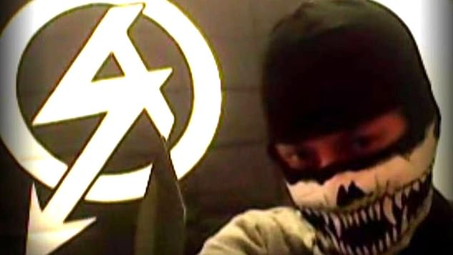 Davies had posted an image of himself in a balaclava with a large knife and the flag of National Action (above) hours before he attempted to decapitate Dr Sarandev Bhambra