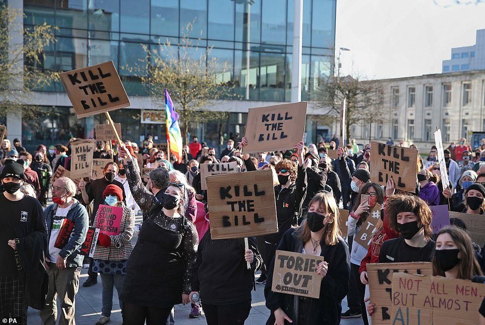Demonstrators gather while holding up placards reading 'Kill the Bill' at a protest in Guildhall Square, Southampton, today