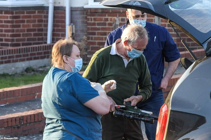 Pictures from the scene showed a vet and assistants preparing a tranquilliser gun outside the house
