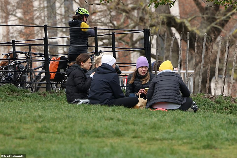A small group gathers in Greenwich Park, south east London, this morning at the start of the long Easter weekend