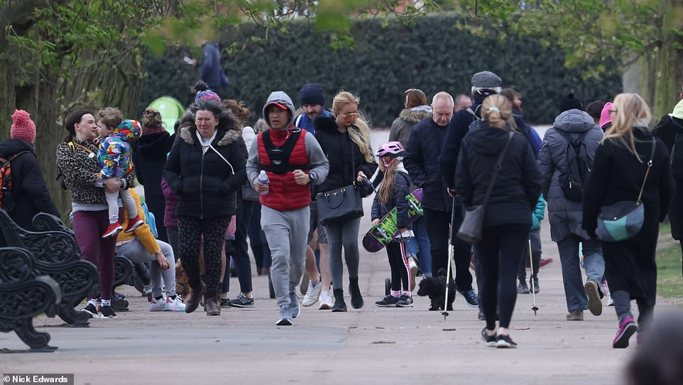 Joggers in Greenwich Park, south east London this morning at the start of the long Easter weekend, with temperatures expected to be mild