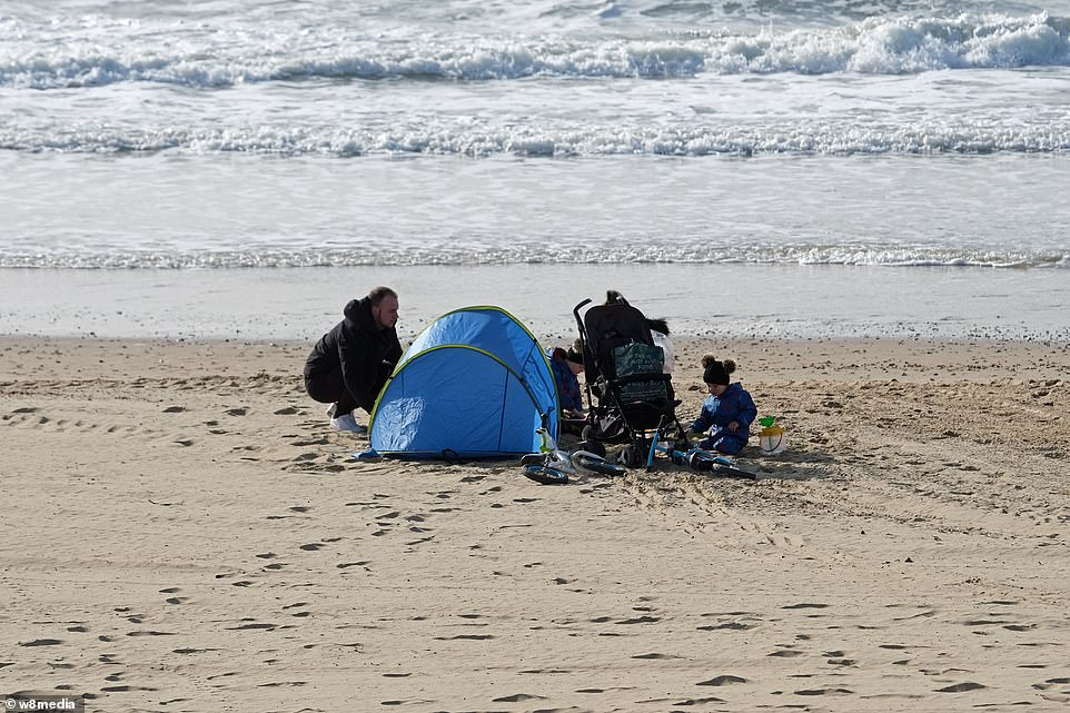 One family set up camp on Bournemouth beach, which is expected to be busy across the four-day Easter weekend