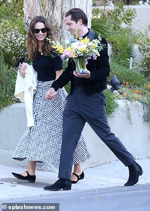 Radiant: Lily looked radiant in a black-and-white chequered skirt which she teamed with a stylish black T-shirt as they visited the house belonging to his mother and father