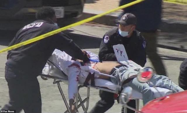 The suspect - who NBC is reporting is dead - is shown being stretchered away from the scene after being shot by a Capitol cop. Two Capitol cops are now in the hospital in a critical condition. He has been named by NBC as 25-year-old Noah Green