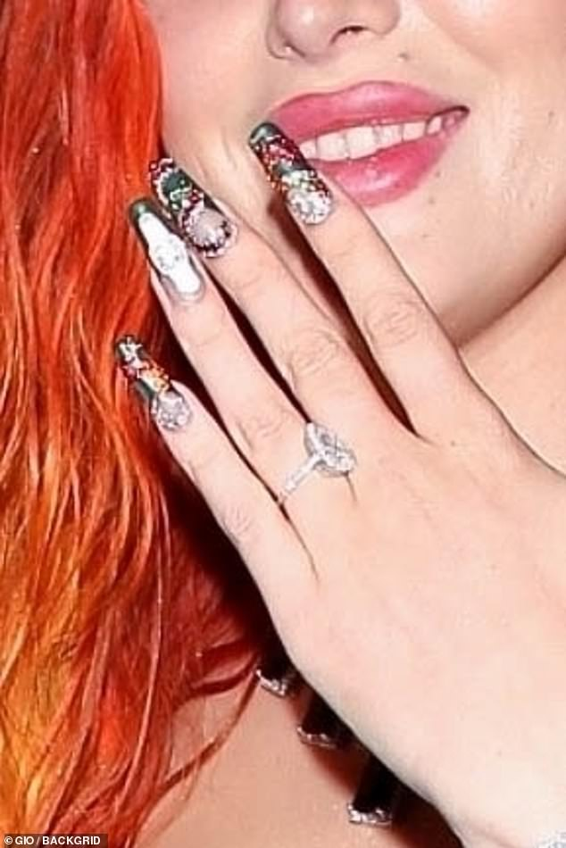 Dazzling: The 23-year-old actress flashed her dazzling engagement ring as she and her man headed out on the town that evening
