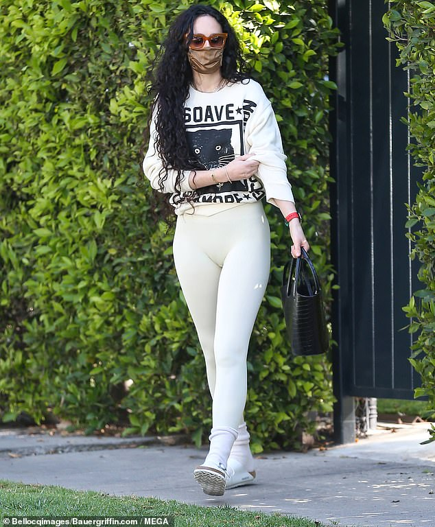 Effortlessly stylish: The actress, 32, completed the look with ivory sandals and socks as she sauntered through California