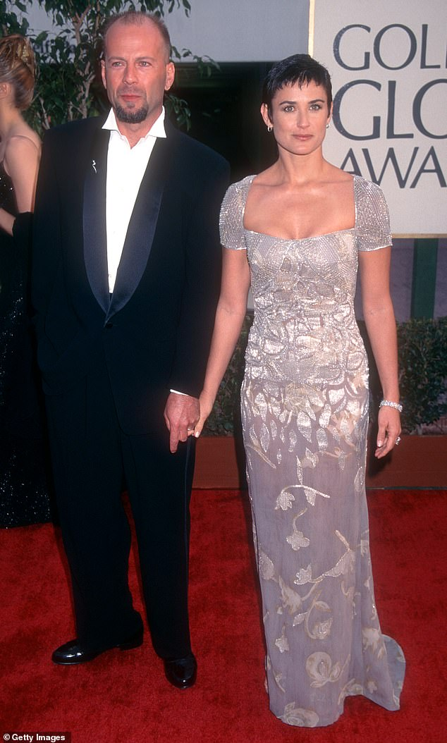 Famous parents: Rumer and her sisters Scout, 29, and Tallulah, 27, were born to Bruce Willis and Demi during their marriage which lasted from 1987 to 2007 (the couple pictured in 1997)