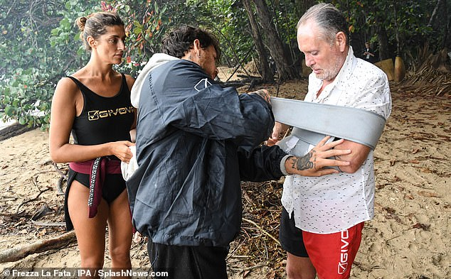 Helping hand:Paul is now sleeping in an actual bed instead of the sandy ground like his campmates, and he will not participate in any more trials, said The Mirror
