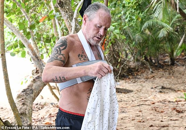 At home:Paul instantly adjusted to island life as he was seen walking through the campsite before changing into a relaxed shirt