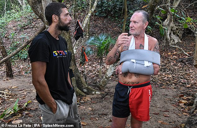 Solider on:Prior to his reentry earlier this week, Paul revealed he would be willing to return to the programme despite his accident (pictured chatting toGilles Rocca)