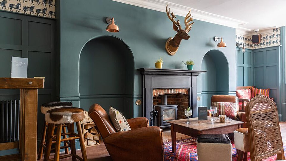 The Bear's necessities: The cosy bar with its wooden floors 'honeyed with age' and comfy scuffed leather armchairs