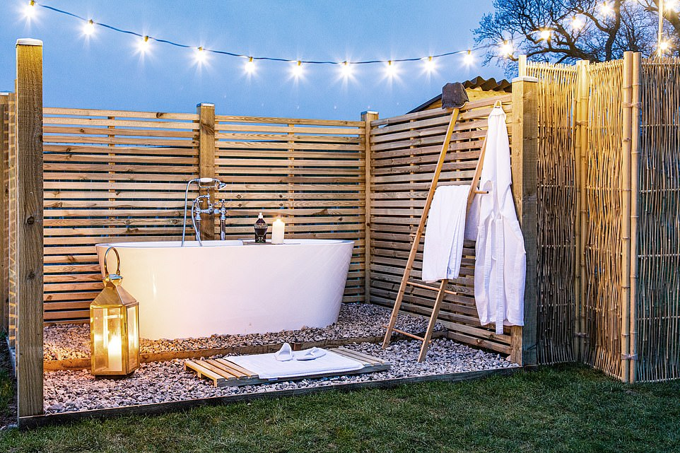 An outdoor bath at the Catkin Huts, which are located on a400-acre working farm near Dorchester in Dorset