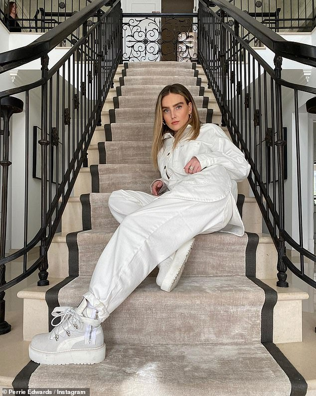 Good one: Perrie Edwards tickled fans after sharing a sultry snap of herself posing on the stairs - while a woman holding a vacuum cleaner patiently waited in the corner