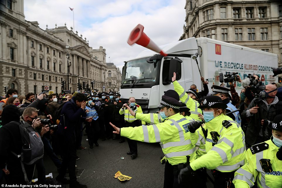 Police intervene as protestors attempt to stop a delivery truck during the 'Kill the Bill' protest held in opposition to the Police, Crime, Sentencing and Courts Bill