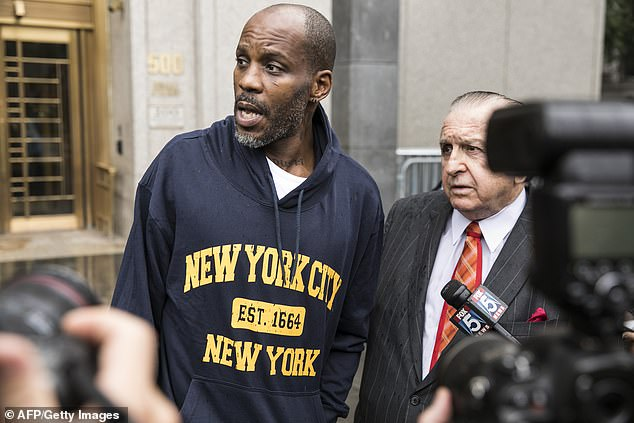 The rap artist, whose real name is Earl Simmons, was released from federal prison in January 2019 after serving a year behind bars for tax fraud. He is pictured leaving court with his attorney in 2017