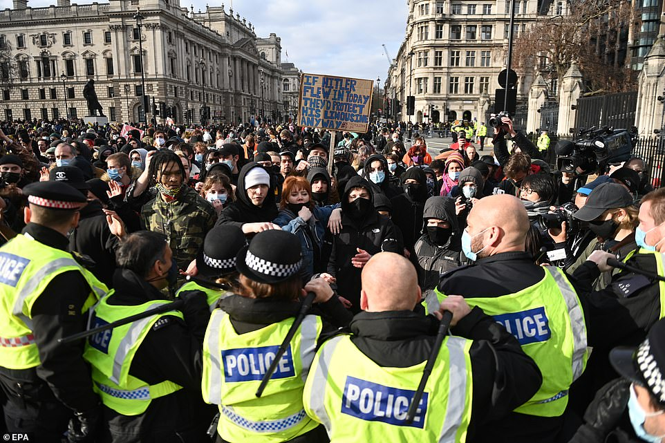 Police scuffle with protestors  during a Kill the Bill