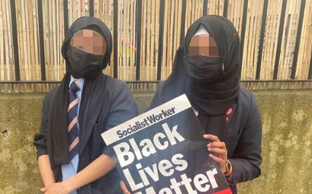 Two schoolgirls holding an SWP poster posed for a photograph, later posted on the revolutionary group's Twitter page