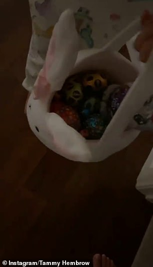 Pictured: Tammy Hembrow's children show their Easter haul in a basket