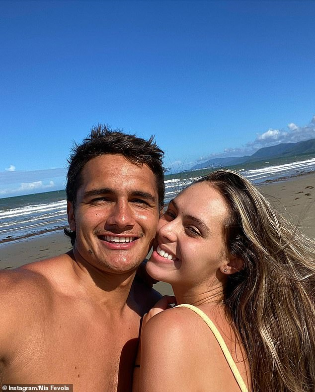 Couple: It comes after Mia was inundated with abusive comments after she shared a photo with her new boyfriend last month. Pictured: Here on the beach