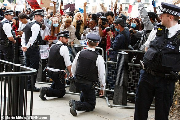 Pictured: Police officers from the Met kneel in solidarity at a Black Lives Matter protest in the wake of the death of George Floyd who was killed by police in Minneapolis in May last year