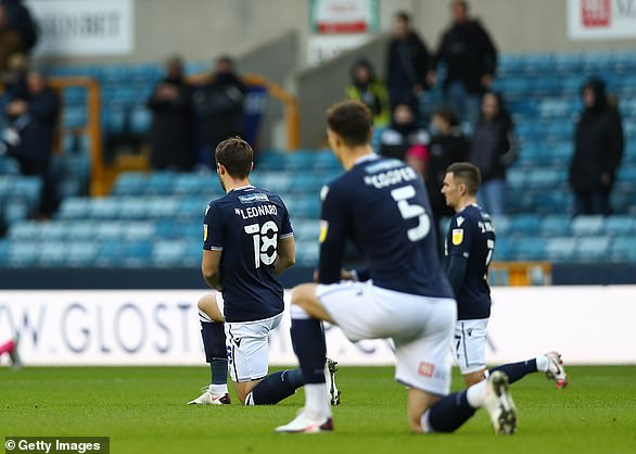 Pictured: Ryan Leonard of Millwall kneeling in solidarity with Black Lives Matter during the Sky Bet Championship match between Millwall and Derby County at the Den on December 5, 2020