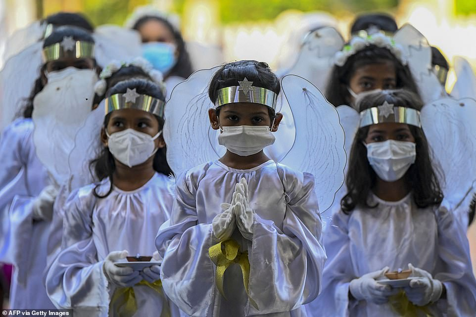 Young Christian devotees attend an Easter mass on the second anniversary of the Easter Sunday attack in Sri Lanka