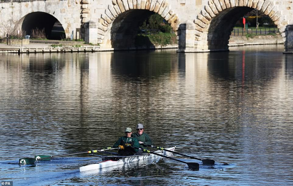 A pair of rowers travel along the River Thames at Maidenhead, Berkshire, on Easter Sunday