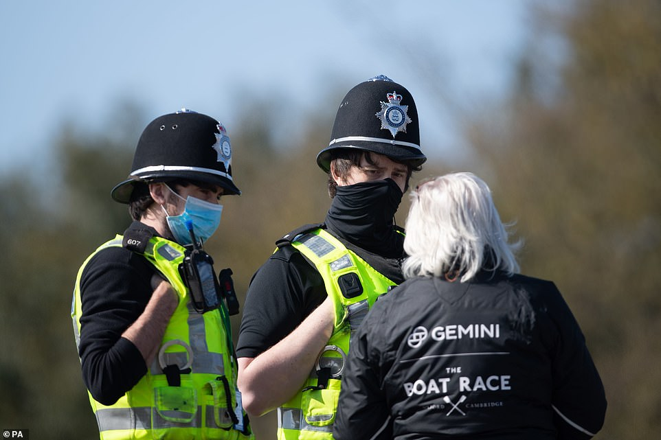 Police near the start line of the Boat Race on the River Great Ouse near Ely in Cambridgeshire