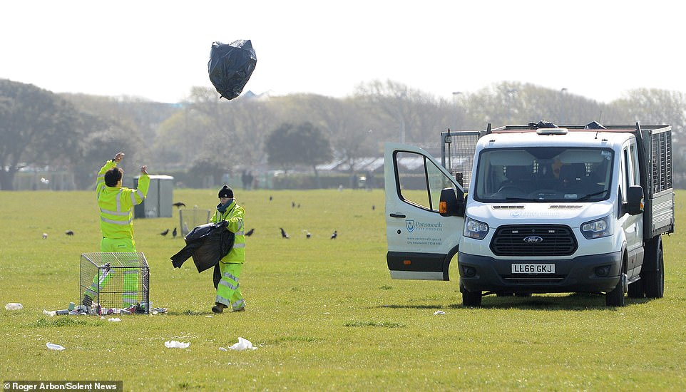 Council workers begin the task of clearing up the litter left on Southsea Common in Hampshire today, following nice weather over the Easter weekend