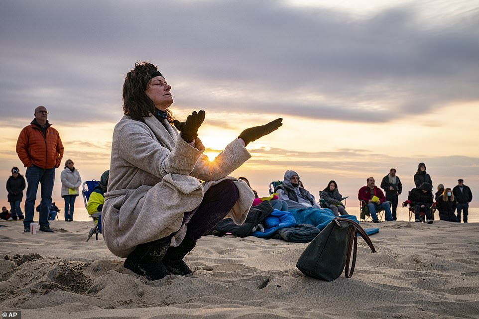 Parishioners gather on a beach for an Easter Sunday service at sunrise hosted by Hope Community Church of Manasquan, New Jersey