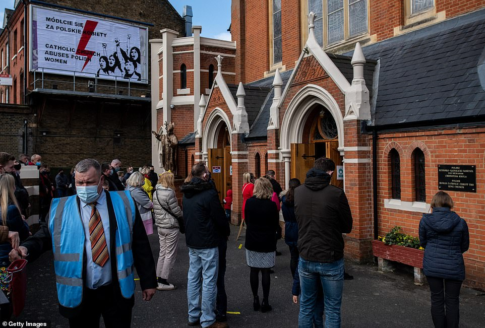 Around 50 smartly-dressed worshippers had to listen to Mass through speakers introduced after police broke up the Good Friday service