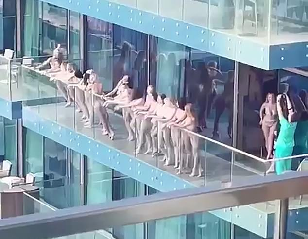 A group of people have been arrested by Dubai police after women were spotted posing naked on a balcony in the city (pictured)