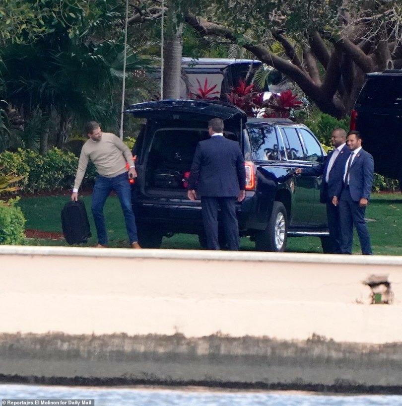 Eric is seen grabbing one last suitcase to pack into the SUV as they prepared to leave Mar-a-Lago on Sunday