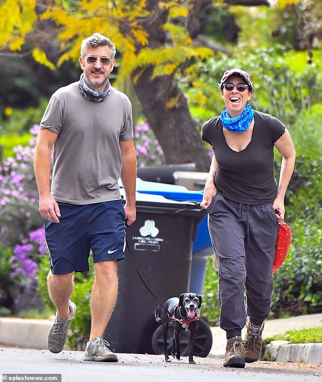 Beaming: Sarah Silverman, 50, and her boyfriend Rory Albanese, 43, appeared to be in great spirits during a walk with her rescue dog Mary in Los Angeles on Sunday