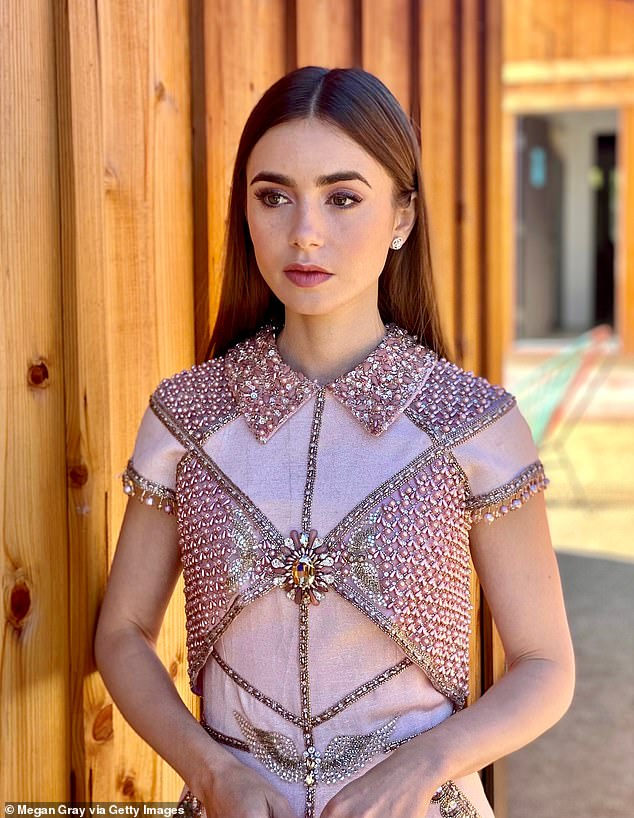 Stunning:Lily Collins, 32, struck a beautiful pose for a glamourous series of snaps ahead of the virtual 27th annual SAG Awards on Sunday night