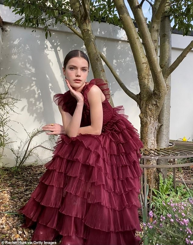 Elegant: The actress, 14, looked incredible in a wine coloured floor length ruffle gown