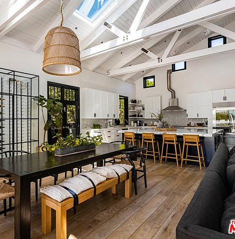 There's a breakfast bar as well as a formal dining area and skylights and high windows allow in plenty of natural light