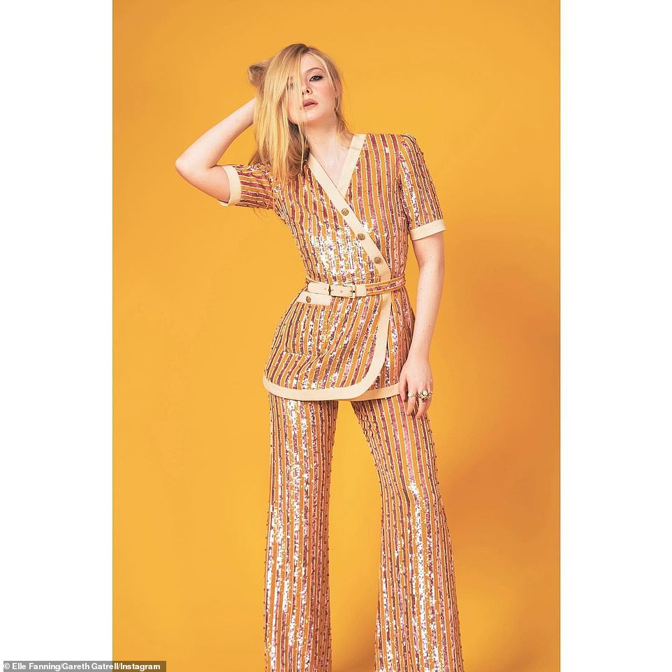 Looking great: She chose a striped, sequined top and matching trousers