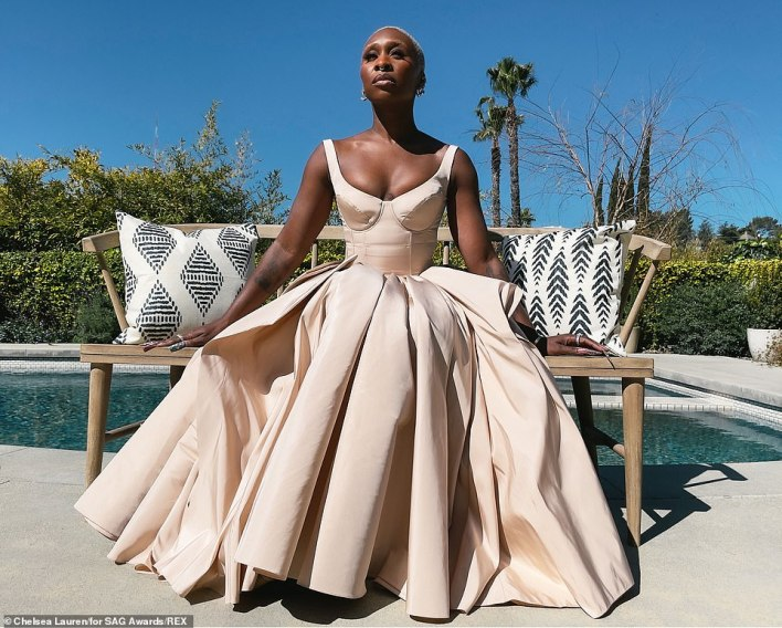 So beautiful: Cynthia Erivo donned a cream hued Alexander McQueen gown featuring a fitted bustier top and a voluminous skirt