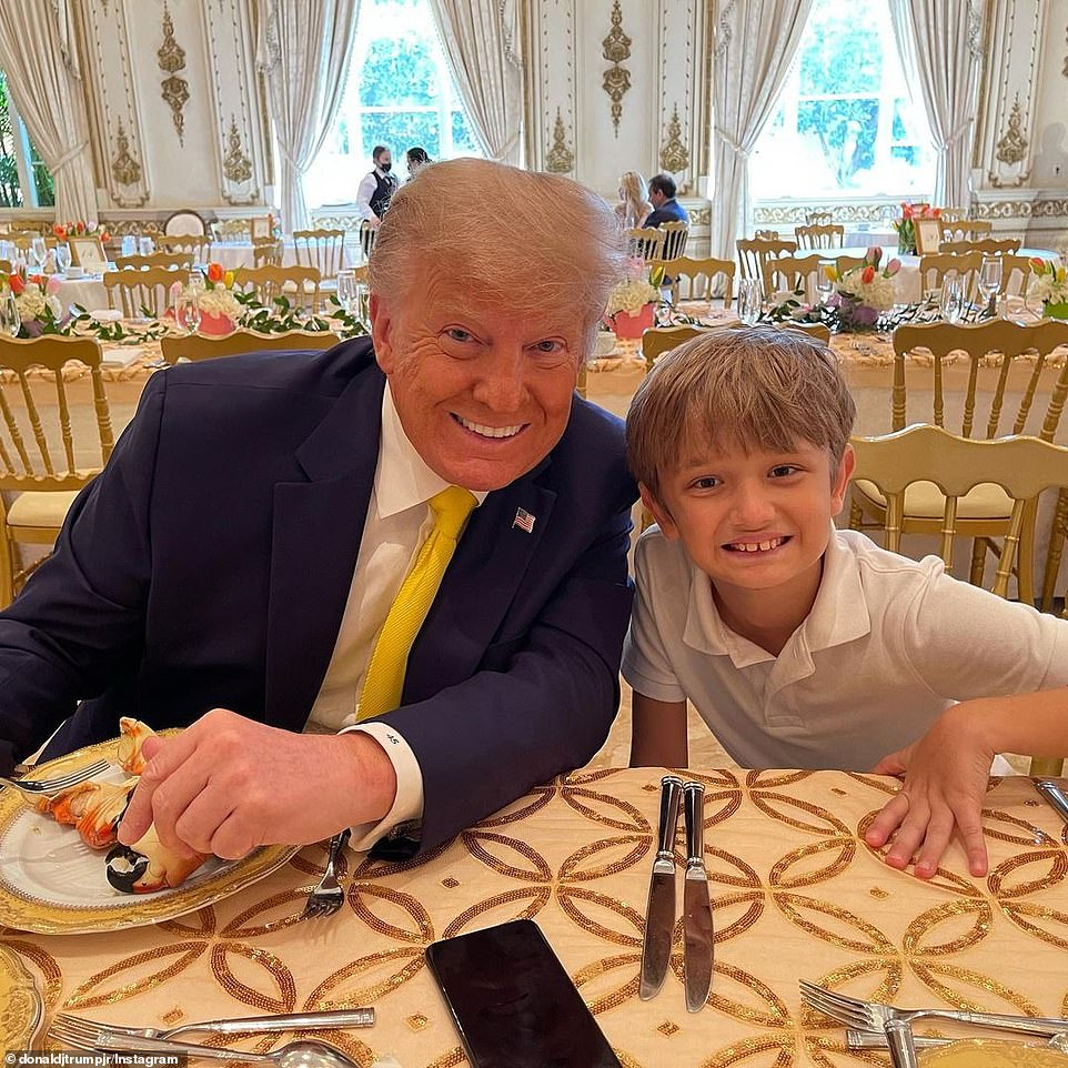 Donald Trump shares a tender moment at Mar-a-Lago on Easter Sunday with one of his grandchildren
