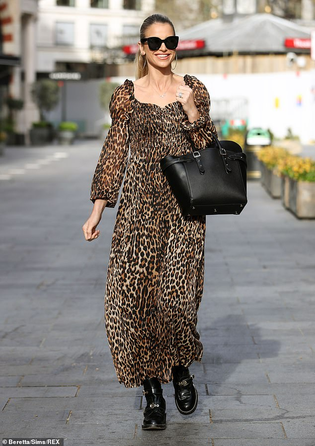 Racy: Vogue Williams turned heads as she left Global Studios in London wearing a leopard print maxi dress on Sunday