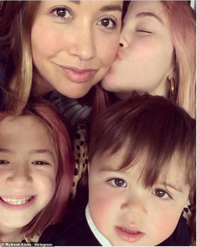 Happy family: Myleene is a proud parent to children Ava, 13, and Hero, nine, with ex Graham Quinn and son Apollo, nineteen months, with fiancé Simon Motson